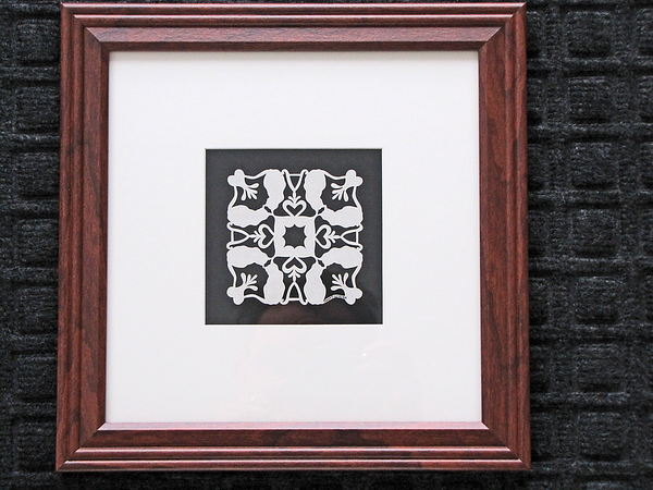 "Title: "" Alex's Cats "" - Framed  Hand Cut Quilt Patterns<br /> Size: 10x10<br /> Difficulty 6 of 10<br /> <br /> <br /> Buy This Item: <a href=""http://www.etsy.com/listing/91325392/alexs-cats-quilt-pattern-custom"">http://www.etsy.com/listing/91325392/alexs-cats-quilt-pattern-custom</a><br /> <br /> Scherenschnitte (hand paper cutting)<br /> Signed and dated by Janet Lynch framed 10x10<br /> Water Mark will not appear on your art order<br /> <br /> ~This paper cutting and all Scherenschnitte Art listed in my shop available as a beautiful print NoteCard. $3.95 ea or $2.95 ea if you order 10 mix or match <a href=""http://www.etsy.com/your/item/edit/71810088?step=publish"">http://www.etsy.com/your/item/edit/71810088?step=publish</a><br /> <br /> ~THIS ITEM SHIPS FREE IN US AND CANADA IF SHIPPED WITH ANY OTHER PURCHASE<br /> <br /> ~Have a special size or request? Just CLICK ON CONTACT AT THE BOTTOM and we'll see what we can work out!<br /> <br /> All images are copyright protected and the exclusive property of Dave Lynch and may not be used without permission. JanetLynchArt@gmail.com"