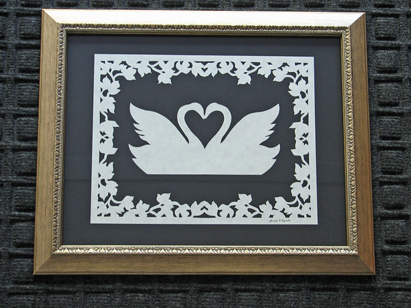 """Title: """"Valentine Swans"""" - Hand Cut Parchment - By Janet Lynch<br /> Size: 10x13<br /> Price:$49 Plus Tax -S&H<br /> Email Janet Lynch Your Order: ArtGalleryRiverRd@gmail.com"""