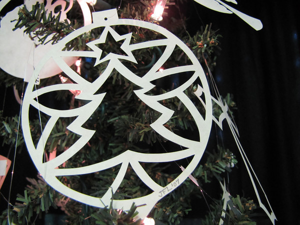 """Title: """"Christmas Tree Ball """" - Hand Cut Parchment<br /> Price: $10<br /> This item ships free in U.S. and Canada when shipped with an equal or lesser item<br /> <br /> ~ Scherenschnitte (hand paper cutting) Christmas Ornament<br /> Signed and dated by Janet Lynch<br /> <br /> ~ All Christmas ornaments can be personalized with names in Calligraphy<br /> Water Mark will not appear on your art order<br /> <br /> ~Want this as a print on a 5x7 Note Card? <a href=""""http://www.etsy.com/listing/71810088/note-cards-5x7-choose-any-photo-or-paper"""">http://www.etsy.com/listing/71810088/note-cards-5x7-choose-any-photo-or-paper</a><br /> <br /> ~ Want this as a print on a jewelry pendant? <a href=""""http://www.etsy.com/listing/74448914/cape-hatteras-lighthouse-fine-art"""">http://www.etsy.com/listing/74448914/cape-hatteras-lighthouse-fine-art</a><br /> <br /> ~ Special Custom requests welcome.....just email me and I will do my best to work with you. If you have a theme or particular interest I am sure I have a design for you......or I will design one just for you.<br /> <br /> ~Visit our shop to see all my hand cut Scherenschnitte Art, Fine Art Photography, Prints, Christmas Ornaments, Bookmarks, Note Cards, Photo Pendants, Jewelry:<br /> <a href=""""http://artgalleryriverrd.etsy.com"""">http://artgalleryriverrd.etsy.com</a>"""