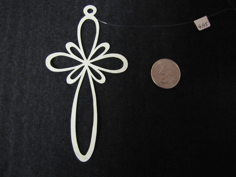 """Title: """" Cross II """" - Hand Cut Parchment Price: $6 This item ships free in U.S. and Canada when shipped with an equal or lesser item  ~ Scherenschnitte (hand paper cutting) Christmas Ornament Signed and dated by Janet Lynch  ~ All Christmas ornaments can be personalized with names in Calligraphy Water Mark will not appear on your art order  ~Want this as a print on a 5x7 Note Card? http://www.etsy.com/listing/71810088/note-cards-5x7-choose-any-photo-or-paper  ~ Want this as a print on a jewelry pendant? http://www.etsy.com/listing/74448914/cape-hatteras-lighthouse-fine-art  ~ Special Custom requests welcome.....just email me and I will do my best to work with you. If you have a theme or particular interest I am sure I have a design for you......or I will design one just for you.  ~Visit our shop to see all my hand cut Scherenschnitte Art, Fine Art Photography, Prints, Christmas Ornaments, Bookmarks, Note Cards, Photo Pendants, Jewelry: http://artgalleryriverrd.etsy.com"""