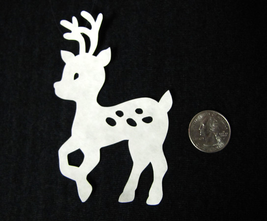 "Title: "" Reindeer "" - Hand Cut Parchment<br /> Price: $6<br /> This item ships free in U.S. and Canada when shipped with an equal or lesser item<br /> <br /> Buy This Item: <a href=""http://www.etsy.com/listing/77477619/christmas-ornaments-scherenschnitte-hand"">http://www.etsy.com/listing/77477619/christmas-ornaments-scherenschnitte-hand</a><br /> <br /> ~ Scherenschnitte (hand paper cutting) Christmas Ornament<br /> Signed and dated by Janet Lynch<br /> <br /> ~ All Christmas ornaments can be personalized with names in Calligraphy<br /> Water Mark will not appear on your art order<br /> <br /> ~Want this as a print on a 5x7 Note Card? <a href=""http://www.etsy.com/listing/71810088/note-cards-5x7-choose-any-photo-or-paper"">http://www.etsy.com/listing/71810088/note-cards-5x7-choose-any-photo-or-paper</a><br /> <br /> ~ Want this as a print on a jewelry pendant? <a href=""http://www.etsy.com/listing/74448914/cape-hatteras-lighthouse-fine-art"">http://www.etsy.com/listing/74448914/cape-hatteras-lighthouse-fine-art</a><br /> <br /> ~ Special Custom requests welcome.....just email me and I will do my best to work with you. If you have a theme or particular interest I am sure I have a design for you......or I will design one just for you."