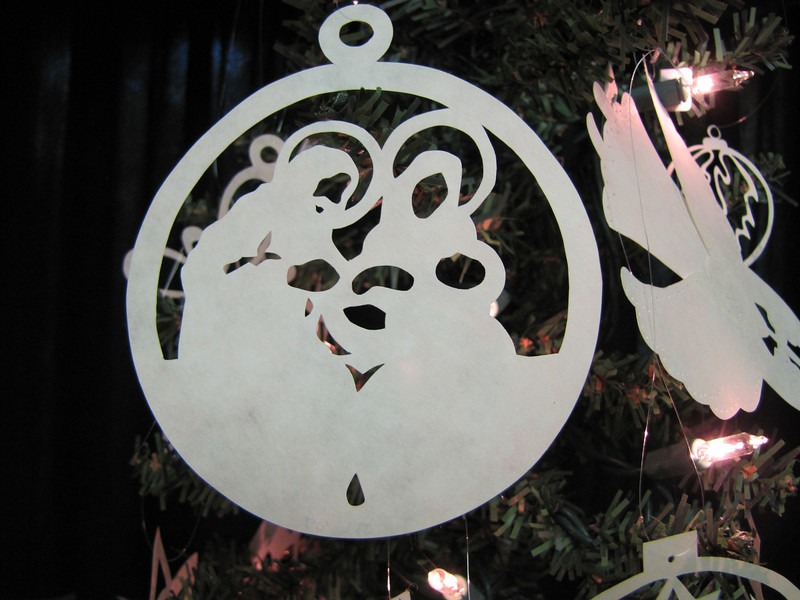 "Title: ""Nativity"" - Hand Cut Parchment Price: $6 This item ships free in U.S. and Canada when shipped with an equal or lesser item  ~ Scherenschnitte (hand paper cutting) Christmas Ornament Signed and dated by Janet Lynch  ~ All Christmas ornaments can be personalized with names in Calligraphy Water Mark will not appear on your art order  ~Want this as a print on a 5x7 Note Card? http://www.etsy.com/listing/71810088/note-cards-5x7-choose-any-photo-or-paper  ~ Want this as a print on a jewelry pendant? http://www.etsy.com/listing/74448914/cape-hatteras-lighthouse-fine-art  ~ Special Custom requests welcome.....just email me and I will do my best to work with you. If you have a theme or particular interest I am sure I have a design for you......or I will design one just for you.  ~Visit our shop to see all my hand cut Scherenschnitte Art, Fine Art Photography, Prints, Christmas Ornaments, Bookmarks, Note Cards, Photo Pendants, Jewelry: http://artgalleryriverrd.etsy.com"