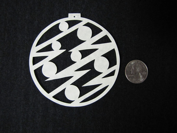 """Title: """" Large Christmas Ball """" - Hand Cut Parchment<br /> Price: $10<br /> This item ships free in U.S. and Canada when shipped with an equal or lesser item<br /> <br /> ~ Scherenschnitte (hand paper cutting) Christmas Ornament<br /> Signed and dated by Janet Lynch<br /> <br /> ~ All Christmas ornaments can be personalized with names in Calligraphy<br /> Water Mark will not appear on your art order<br /> <br /> ~Want this as a print on a 5x7 Note Card? <a href=""""http://www.etsy.com/listing/71810088/note-cards-5x7-choose-any-photo-or-paper"""">http://www.etsy.com/listing/71810088/note-cards-5x7-choose-any-photo-or-paper</a><br /> <br /> ~ Want this as a print on a jewelry pendant? <a href=""""http://www.etsy.com/listing/74448914/cape-hatteras-lighthouse-fine-art"""">http://www.etsy.com/listing/74448914/cape-hatteras-lighthouse-fine-art</a><br /> <br /> ~ Special Custom requests welcome.....just email me and I will do my best to work with you. If you have a theme or particular interest I am sure I have a design for you......or I will design one just for you.<br /> <br /> ~Visit our shop to see all my hand cut Scherenschnitte Art, Fine Art Photography, Prints, Christmas Ornaments, Bookmarks, Note Cards, Photo Pendants, Jewelry:<br /> <a href=""""http://artgalleryriverrd.etsy.com"""">http://artgalleryriverrd.etsy.com</a>"""