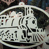 "Title: "" Train "" - Hand Cut Parchment<br /> Price: $10<br /> This item ships free in U.S. and Canada when shipped with an equal or lesser item<br /> <br /> ~ Scherenschnitte (hand paper cutting) Christmas Ornament<br /> Signed and dated by Janet Lynch<br /> <br /> ~ All Christmas ornaments can be personalized with names in Calligraphy<br /> Water Mark will not appear on your art order<br /> <br /> ~Want this as a print on a 5x7 Note Card? <a href=""http://www.etsy.com/listing/71810088/note-cards-5x7-choose-any-photo-or-paper"">http://www.etsy.com/listing/71810088/note-cards-5x7-choose-any-photo-or-paper</a><br /> <br /> ~ Want this as a print on a jewelry pendant? <a href=""http://www.etsy.com/listing/74448914/cape-hatteras-lighthouse-fine-art"">http://www.etsy.com/listing/74448914/cape-hatteras-lighthouse-fine-art</a><br /> <br /> ~ Special Custom requests welcome.....just email me and I will do my best to work with you. If you have a theme or particular interest I am sure I have a design for you......or I will design one just for you.<br /> <br /> ~Visit our shop to see all my hand cut Scherenschnitte Art, Fine Art Photography, Prints, Christmas Ornaments, Bookmarks, Note Cards, Photo Pendants, Jewelry:<br /> <a href=""http://artgalleryriverrd.etsy.com"">http://artgalleryriverrd.etsy.com</a>"