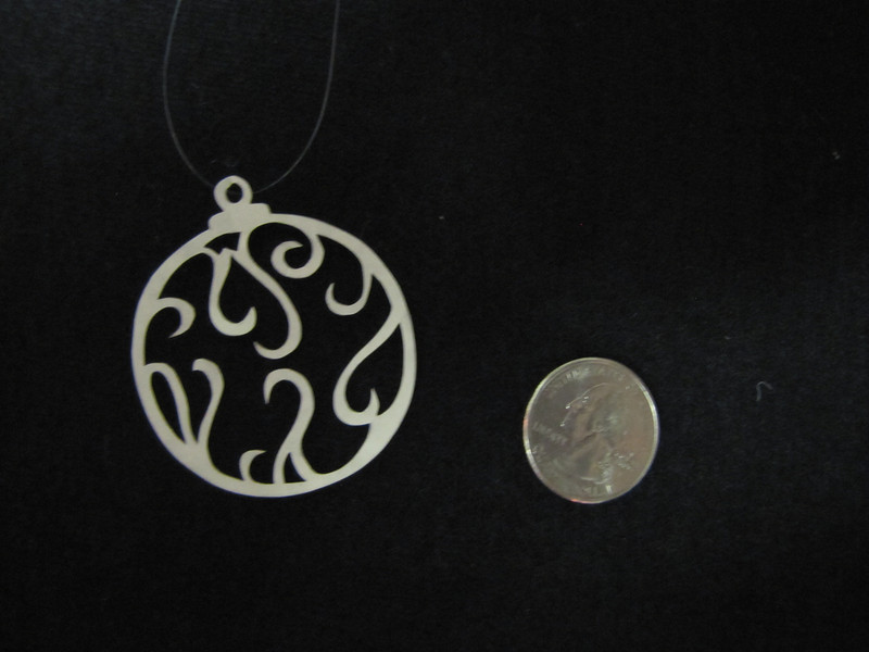 """Title: """"Christmas Ball II """" - Hand Cut Parchment Price: $6 This item ships free in U.S. and Canada when shipped with an equal or lesser item  ~ Scherenschnitte (hand paper cutting) Christmas Ornament Signed and dated by Janet Lynch  ~ All Christmas ornaments can be personalized with names in Calligraphy Water Mark will not appear on your art order  ~Want this as a print on a 5x7 Note Card? http://www.etsy.com/listing/71810088/note-cards-5x7-choose-any-photo-or-paper  ~ Want this as a print on a jewelry pendant? http://www.etsy.com/listing/74448914/cape-hatteras-lighthouse-fine-art  ~ Special Custom requests welcome.....just email me and I will do my best to work with you. If you have a theme or particular interest I am sure I have a design for you......or I will design one just for you.  ~Visit our shop to see all my hand cut Scherenschnitte Art, Fine Art Photography, Prints, Christmas Ornaments, Bookmarks, Note Cards, Photo Pendants, Jewelry: http://artgalleryriverrd.etsy.com"""