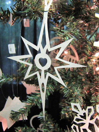 """Title: """" Guiding Star II """" - Hand Cut Parchment Price: $6 This item ships free in U.S. and Canada when shipped with an equal or lesser item  Buy This Item: http://www.etsy.com/listing/79689429/christmas-ornaments-scherenschnitte-hand  ~ Scherenschnitte (hand paper cutting) Christmas Ornament Signed and dated by Janet Lynch  ~ All Christmas ornaments can be personalized with names in Calligraphy Water Mark will not appear on your art order  ~Want this as a print on a 5x7 Note Card? http://www.etsy.com/listing/71810088/note-cards-5x7-choose-any-photo-or-paper  ~ Want this as a print on a jewelry pendant? http://www.etsy.com/listing/74448914/cape-hatteras-lighthouse-fine-art  ~ Special Custom requests welcome.....just email me and I will do my best to work with you. If you have a theme or particular interest I am sure I have a design for you......or I will design one just for you."""