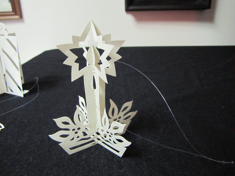"Title: "" 3D Candle "" - Hand Cut Parchment Price: $10 This item ships free in U.S. and Canada when shipped with an equal or lesser item  ~ Scherenschnitte (hand paper cutting) Christmas Ornament Signed and dated by Janet Lynch  ~ All Christmas ornaments can be personalized with names in Calligraphy Water Mark will not appear on your art order  ~Want this as a print on a 5x7 Note Card? http://www.etsy.com/listing/71810088/note-cards-5x7-choose-any-photo-or-paper  ~ Want this as a print on a jewelry pendant? http://www.etsy.com/listing/74448914/cape-hatteras-lighthouse-fine-art  ~ Special Custom requests welcome.....just email me and I will do my best to work with you. If you have a theme or particular interest I am sure I have a design for you......or I will design one just for you.  ~Visit our shop to see all my hand cut Scherenschnitte Art, Fine Art Photography, Prints, Christmas Ornaments, Bookmarks, Note Cards, Photo Pendants, Jewelry: http://artgalleryriverrd.etsy.com"