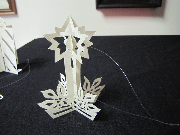 "Title: "" 3D Candle "" - Hand Cut Parchment<br /> Price: $10<br /> This item ships free in U.S. and Canada when shipped with an equal or lesser item<br /> <br /> ~ Scherenschnitte (hand paper cutting) Christmas Ornament<br /> Signed and dated by Janet Lynch<br /> <br /> ~ All Christmas ornaments can be personalized with names in Calligraphy<br /> Water Mark will not appear on your art order<br /> <br /> ~Want this as a print on a 5x7 Note Card? <a href=""http://www.etsy.com/listing/71810088/note-cards-5x7-choose-any-photo-or-paper"">http://www.etsy.com/listing/71810088/note-cards-5x7-choose-any-photo-or-paper</a><br /> <br /> ~ Want this as a print on a jewelry pendant? <a href=""http://www.etsy.com/listing/74448914/cape-hatteras-lighthouse-fine-art"">http://www.etsy.com/listing/74448914/cape-hatteras-lighthouse-fine-art</a><br /> <br /> ~ Special Custom requests welcome.....just email me and I will do my best to work with you. If you have a theme or particular interest I am sure I have a design for you......or I will design one just for you.<br /> <br /> ~Visit our shop to see all my hand cut Scherenschnitte Art, Fine Art Photography, Prints, Christmas Ornaments, Bookmarks, Note Cards, Photo Pendants, Jewelry:<br /> <a href=""http://artgalleryriverrd.etsy.com"">http://artgalleryriverrd.etsy.com</a>"