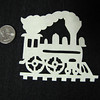 "Title: ""Train On Track "" - Hand Cut Parchment<br /> Price: $6<br /> This item ships free in U.S. and Canada when shipped with an equal or lesser item<br /> <br /> Buy This Item: <a href=""http://www.etsy.com/listing/79688445/christmas-ornaments-scherenschnitte-hand"">http://www.etsy.com/listing/79688445/christmas-ornaments-scherenschnitte-hand</a><br /> <br /> ~ Scherenschnitte (hand paper cutting) Christmas Ornament<br /> Signed and dated by Janet Lynch<br /> <br /> ~ All Christmas ornaments can be personalized with names in Calligraphy<br /> Water Mark will not appear on your art order<br /> <br /> ~Want this as a print on a 5x7 Note Card? <a href=""http://www.etsy.com/listing/71810088/note-cards-5x7-choose-any-photo-or-paper"">http://www.etsy.com/listing/71810088/note-cards-5x7-choose-any-photo-or-paper</a><br /> <br /> ~ Want this as a print on a jewelry pendant? <a href=""http://www.etsy.com/listing/74448914/cape-hatteras-lighthouse-fine-art"">http://www.etsy.com/listing/74448914/cape-hatteras-lighthouse-fine-art</a><br /> <br /> ~ Special Custom requests welcome.....just email me and I will do my best to work with you. If you have a theme or particular interest I am sure I have a design for you......or I will design one just for you."