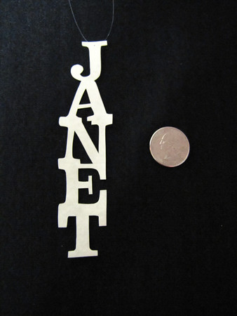 """Title: """"Your Name"""" - Hand Cut Parchment<br /> Price: $6<br /> This item ships free in U.S. and Canada when shipped with an equal or lesser item<br /> <br /> ~ Scherenschnitte (hand paper cutting) Christmas Ornament<br /> Signed and dated by Janet Lynch<br /> <br /> ~ All Christmas ornaments can be personalized with names in Calligraphy<br /> Water Mark will not appear on your art order<br /> <br /> ~Want this as a print on a 5x7 Note Card? <a href=""""http://www.etsy.com/listing/71810088/note-cards-5x7-choose-any-photo-or-paper"""">http://www.etsy.com/listing/71810088/note-cards-5x7-choose-any-photo-or-paper</a><br /> <br /> ~ Want this as a print on a jewelry pendant? <a href=""""http://www.etsy.com/listing/74448914/cape-hatteras-lighthouse-fine-art"""">http://www.etsy.com/listing/74448914/cape-hatteras-lighthouse-fine-art</a><br /> <br /> ~ Special Custom requests welcome.....just email me and I will do my best to work with you. If you have a theme or particular interest I am sure I have a design for you......or I will design one just for you.<br /> <br /> ~Visit our shop to see all my hand cut Scherenschnitte Art, Fine Art Photography, Prints, Christmas Ornaments, Bookmarks, Note Cards, Photo Pendants, Jewelry:<br /> <a href=""""http://artgalleryriverrd.etsy.com"""">http://artgalleryriverrd.etsy.com</a>"""