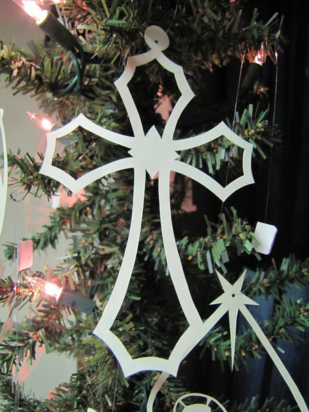 "Title: "" Cross "" - Hand Cut Parchment Price: $6 This item ships free in U.S. and Canada when shipped with an equal or lesser item  ~ Scherenschnitte (hand paper cutting) Christmas Ornament Signed and dated by Janet Lynch  ~ All Christmas ornaments can be personalized with names in Calligraphy Water Mark will not appear on your art order  ~Want this as a print on a 5x7 Note Card? http://www.etsy.com/listing/71810088/note-cards-5x7-choose-any-photo-or-paper  ~ Want this as a print on a jewelry pendant? http://www.etsy.com/listing/74448914/cape-hatteras-lighthouse-fine-art  ~ Special Custom requests welcome.....just email me and I will do my best to work with you. If you have a theme or particular interest I am sure I have a design for you......or I will design one just for you.  ~Visit our shop to see all my hand cut Scherenschnitte Art, Fine Art Photography, Prints, Christmas Ornaments, Bookmarks, Note Cards, Photo Pendants, Jewelry: http://artgalleryriverrd.etsy.com"