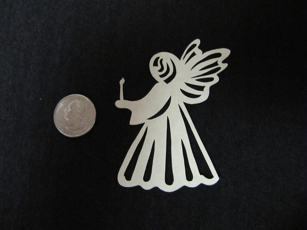"""Title: """"Angel With Candle """" - Hand Cut Parchment<br /> Price: $6<br /> This item ships free in U.S. and Canada when shipped with an equal or lesser item<br /> <br /> Buy This Item: <a href=""""http://www.etsy.com/listing/79684375/christmas-ornaments-scherenschnitte-hand"""">http://www.etsy.com/listing/79684375/christmas-ornaments-scherenschnitte-hand</a><br /> <br /> ~ Scherenschnitte (hand paper cutting) Christmas Ornament<br /> Signed and dated by Janet Lynch<br /> <br /> ~ All Christmas ornaments can be personalized with names in Calligraphy<br /> Water Mark will not appear on your art order<br /> <br /> ~Want this as a print on a 5x7 Note Card? <a href=""""http://www.etsy.com/listing/71810088/note-cards-5x7-choose-any-photo-or-paper"""">http://www.etsy.com/listing/71810088/note-cards-5x7-choose-any-photo-or-paper</a><br /> <br /> ~ Want this as a print on a jewelry pendant? <a href=""""http://www.etsy.com/listing/74448914/cape-hatteras-lighthouse-fine-art"""">http://www.etsy.com/listing/74448914/cape-hatteras-lighthouse-fine-art</a><br /> <br /> ~ Special Custom requests welcome.....just email me and I will do my best to work with you. If you have a theme or particular interest I am sure I have a design for you......or I will design one just for you."""