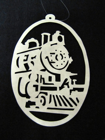 "Title: ""Train II "" - Hand Cut Parchment<br /> Price: $10<br /> This item ships free in U.S. and Canada when shipped with an equal or lesser item<br /> <br /> ~ Scherenschnitte (hand paper cutting) Christmas Ornament<br /> Signed and dated by Janet Lynch<br /> <br /> ~ All Christmas ornaments can be personalized with names in Calligraphy<br /> Water Mark will not appear on your art order<br /> <br /> ~Want this as a print on a 5x7 Note Card? <a href=""http://www.etsy.com/listing/71810088/note-cards-5x7-choose-any-photo-or-paper"">http://www.etsy.com/listing/71810088/note-cards-5x7-choose-any-photo-or-paper</a><br /> <br /> ~ Want this as a print on a jewelry pendant? <a href=""http://www.etsy.com/listing/74448914/cape-hatteras-lighthouse-fine-art"">http://www.etsy.com/listing/74448914/cape-hatteras-lighthouse-fine-art</a><br /> <br /> ~ Special Custom requests welcome.....just email me and I will do my best to work with you. If you have a theme or particular interest I am sure I have a design for you......or I will design one just for you.<br /> <br /> ~Visit our shop to see all my hand cut Scherenschnitte Art, Fine Art Photography, Prints, Christmas Ornaments, Bookmarks, Note Cards, Photo Pendants, Jewelry:<br /> <a href=""http://artgalleryriverrd.etsy.com"">http://artgalleryriverrd.etsy.com</a>"