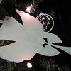 "Title: ""Angel With Trumpet"" - Hand Cut Parchment<br /> Price: $8<br /> This item ships free in U.S. and Canada when shipped with an equal or lesser item<br /> <br /> ~ Scherenschnitte (hand paper cutting) Christmas Ornament<br /> Signed and dated by Janet Lynch<br /> <br /> ~ All Christmas ornaments can be personalized with names in Calligraphy<br /> Water Mark will not appear on your art order<br /> <br /> ~Want this as a print on a 5x7 Note Card? <a href=""http://www.etsy.com/listing/71810088/note-cards-5x7-choose-any-photo-or-paper"">http://www.etsy.com/listing/71810088/note-cards-5x7-choose-any-photo-or-paper</a><br /> <br /> ~ Want this as a print on a jewelry pendant? <a href=""http://www.etsy.com/listing/74448914/cape-hatteras-lighthouse-fine-art"">http://www.etsy.com/listing/74448914/cape-hatteras-lighthouse-fine-art</a><br /> <br /> ~ Special Custom requests welcome.....just email me and I will do my best to work with you. If you have a theme or particular interest I am sure I have a design for you......or I will design one just for you.<br /> <br /> ~Visit our shop to see all my hand cut Scherenschnitte Art, Fine Art Photography, Prints, Christmas Ornaments, Bookmarks, Note Cards, Photo Pendants, Jewelry:<br /> <a href=""http://artgalleryriverrd.etsy.com"">http://artgalleryriverrd.etsy.com</a>"