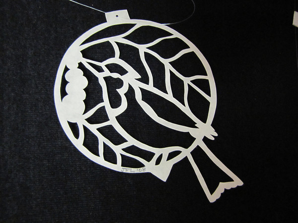 """Title: """" Bird and Berries """" - Hand Cut Parchment<br /> Price: $10<br /> This item ships free in U.S. and Canada when shipped with an equal or lesser item<br /> <br /> ~ Scherenschnitte (hand paper cutting) Christmas Ornament<br /> Signed and dated by Janet Lynch<br /> <br /> ~ All Christmas ornaments can be personalized with names in Calligraphy<br /> Water Mark will not appear on your art order<br /> <br /> ~Want this as a print on a 5x7 Note Card? <a href=""""http://www.etsy.com/listing/71810088/note-cards-5x7-choose-any-photo-or-paper"""">http://www.etsy.com/listing/71810088/note-cards-5x7-choose-any-photo-or-paper</a><br /> <br /> ~ Want this as a print on a jewelry pendant? <a href=""""http://www.etsy.com/listing/74448914/cape-hatteras-lighthouse-fine-art"""">http://www.etsy.com/listing/74448914/cape-hatteras-lighthouse-fine-art</a><br /> <br /> ~ Special Custom requests welcome.....just email me and I will do my best to work with you. If you have a theme or particular interest I am sure I have a design for you......or I will design one just for you.<br /> <br /> ~Visit our shop to see all my hand cut Scherenschnitte Art, Fine Art Photography, Prints, Christmas Ornaments, Bookmarks, Note Cards, Photo Pendants, Jewelry:<br /> <a href=""""http://artgalleryriverrd.etsy.com"""">http://artgalleryriverrd.etsy.com</a>"""
