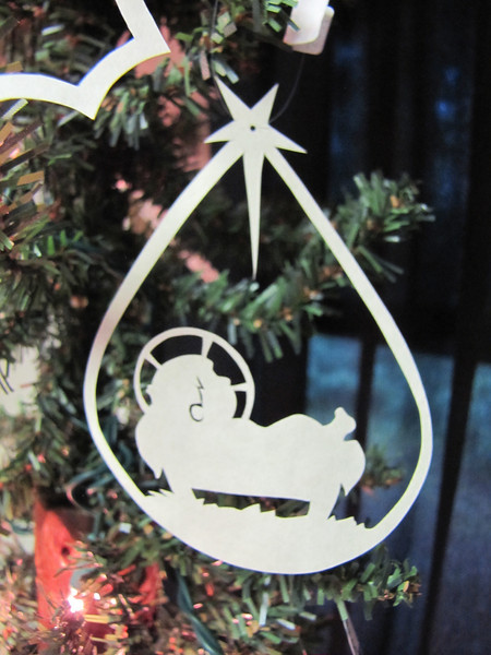 "Title: "" Baby Jesus "" - Hand Cut Parchment Price: $6 This item ships free in U.S. and Canada when shipped with an equal or lesser item  ~ Scherenschnitte (hand paper cutting) Christmas Ornament Signed and dated by Janet Lynch  ~ All Christmas ornaments can be personalized with names in Calligraphy Water Mark will not appear on your art order  ~Want this as a print on a 5x7 Note Card? http://www.etsy.com/listing/71810088/note-cards-5x7-choose-any-photo-or-paper  ~ Want this as a print on a jewelry pendant? http://www.etsy.com/listing/74448914/cape-hatteras-lighthouse-fine-art  ~ Special Custom requests welcome.....just email me and I will do my best to work with you. If you have a theme or particular interest I am sure I have a design for you......or I will design one just for you.  ~Visit our shop to see all my hand cut Scherenschnitte Art, Fine Art Photography, Prints, Christmas Ornaments, Bookmarks, Note Cards, Photo Pendants, Jewelry: http://artgalleryriverrd.etsy.com"
