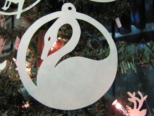 "Title: ""Swan "" - Hand Cut Parchment Price: $6 This item ships free in U.S. and Canada when shipped with an equal or lesser item  Buy This Item: http://www.etsy.com/listing/79689226/christmas-ornaments-scherenschnitte-hand  ~ Scherenschnitte (hand paper cutting) Christmas Ornament Signed and dated by Janet Lynch  ~ All Christmas ornaments can be personalized with names in Calligraphy Water Mark will not appear on your art order  ~Want this as a print on a 5x7 Note Card? http://www.etsy.com/listing/71810088/note-cards-5x7-choose-any-photo-or-paper  ~ Want this as a print on a jewelry pendant? http://www.etsy.com/listing/74448914/cape-hatteras-lighthouse-fine-art  ~ Special Custom requests welcome.....just email me and I will do my best to work with you. If you have a theme or particular interest I am sure I have a design for you......or I will design one just for you."