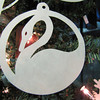"Title: ""Swan "" - Hand Cut Parchment<br /> Price: $6<br /> This item ships free in U.S. and Canada when shipped with an equal or lesser item<br /> <br /> Buy This Item: <a href=""http://www.etsy.com/listing/79689226/christmas-ornaments-scherenschnitte-hand"">http://www.etsy.com/listing/79689226/christmas-ornaments-scherenschnitte-hand</a><br /> <br /> ~ Scherenschnitte (hand paper cutting) Christmas Ornament<br /> Signed and dated by Janet Lynch<br /> <br /> ~ All Christmas ornaments can be personalized with names in Calligraphy<br /> Water Mark will not appear on your art order<br /> <br /> ~Want this as a print on a 5x7 Note Card? <a href=""http://www.etsy.com/listing/71810088/note-cards-5x7-choose-any-photo-or-paper"">http://www.etsy.com/listing/71810088/note-cards-5x7-choose-any-photo-or-paper</a><br /> <br /> ~ Want this as a print on a jewelry pendant? <a href=""http://www.etsy.com/listing/74448914/cape-hatteras-lighthouse-fine-art"">http://www.etsy.com/listing/74448914/cape-hatteras-lighthouse-fine-art</a><br /> <br /> ~ Special Custom requests welcome.....just email me and I will do my best to work with you. If you have a theme or particular interest I am sure I have a design for you......or I will design one just for you."