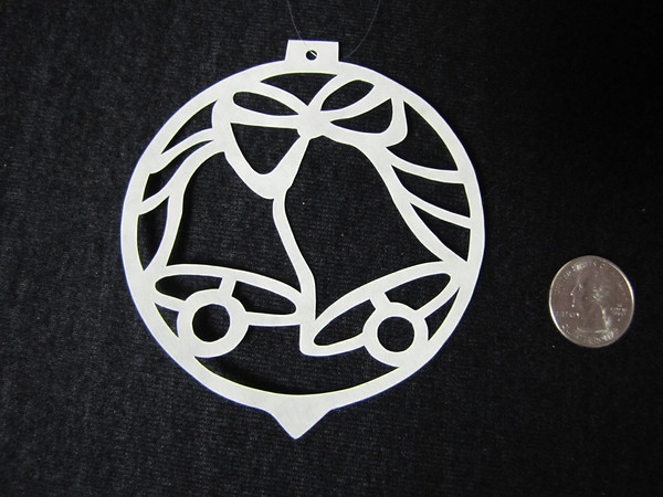 """Title: """"Silver Bells """" - Hand Cut Parchment<br /> Price: $10<br /> This item ships free in U.S. and Canada when shipped with an equal or lesser item<br /> <br /> ~ Scherenschnitte (hand paper cutting) Christmas Ornament<br /> Signed and dated by Janet Lynch<br /> <br /> ~ All Christmas ornaments can be personalized with names in Calligraphy<br /> Water Mark will not appear on your art order<br /> <br /> ~Want this as a print on a 5x7 Note Card? <a href=""""http://www.etsy.com/listing/71810088/note-cards-5x7-choose-any-photo-or-paper"""">http://www.etsy.com/listing/71810088/note-cards-5x7-choose-any-photo-or-paper</a><br /> <br /> ~ Want this as a print on a jewelry pendant? <a href=""""http://www.etsy.com/listing/74448914/cape-hatteras-lighthouse-fine-art"""">http://www.etsy.com/listing/74448914/cape-hatteras-lighthouse-fine-art</a><br /> <br /> ~ Special Custom requests welcome.....just email me and I will do my best to work with you. If you have a theme or particular interest I am sure I have a design for you......or I will design one just for you.<br /> <br /> ~Visit our shop to see all my hand cut Scherenschnitte Art, Fine Art Photography, Prints, Christmas Ornaments, Bookmarks, Note Cards, Photo Pendants, Jewelry:<br /> <a href=""""http://artgalleryriverrd.etsy.com"""">http://artgalleryriverrd.etsy.com</a>"""
