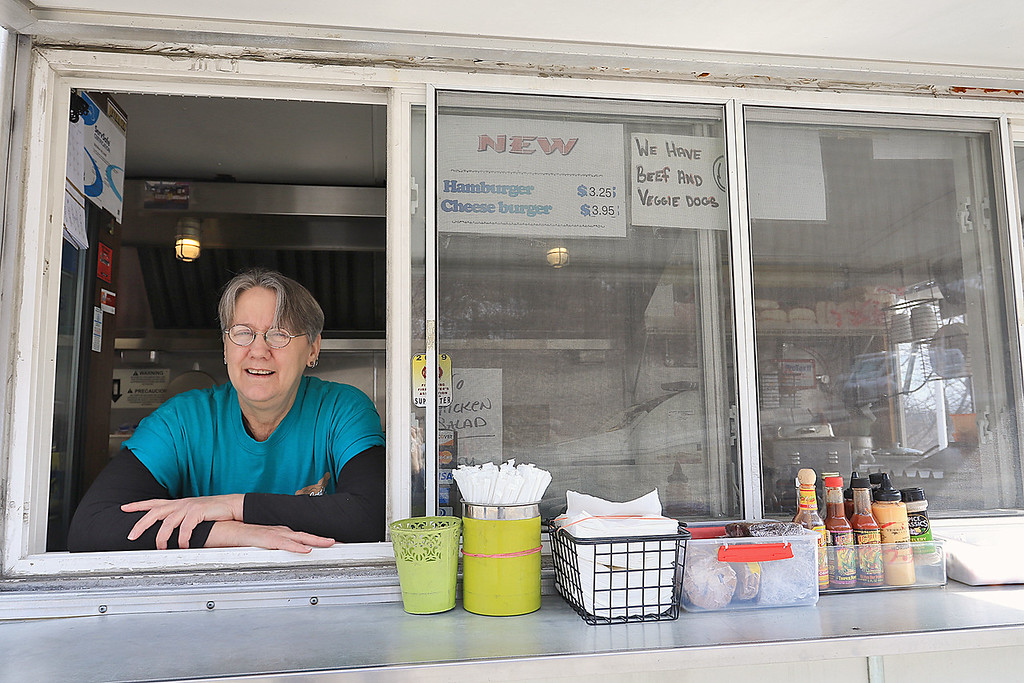 . Janet\'s Chili Dogs in Fitchburg is one of the local seasonal eateries in the North Central MA region. Owner Debby Williams in the window of her establishment on Thursday morning just after she opened. SENTINEL & ENTERPRISE/JOHN LOVE