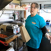 Janet's Chili Dogs in Fitchburg is one of the local seasonal eateries in the North Central MA region. Owner Debby Williams talks about her establishment on Thursday morning as she cooks up a customers order. SENTINEL & ENTERPRISE/JOHN LOVE