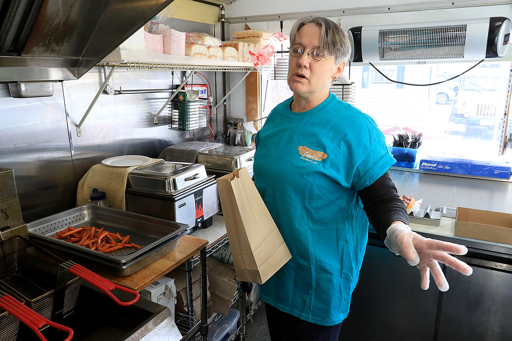 . Janet\'s Chili Dogs in Fitchburg is one of the local seasonal eateries in the North Central MA region. Owner Debby Williams talks about her establishment on Thursday morning as she cooks up a customers order. SENTINEL & ENTERPRISE/JOHN LOVE