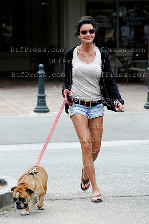 Janice Dickinson take a walk with her dog iand poses for the photographer n Malibu