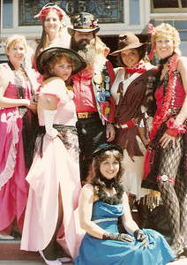 My troupe of saloon girls... 1984-86.  We dressed up in our outfits and rode in parades at events like Kit Carson Mountain Man Days, Rough & Ready Days, bluegrass festivals, the Camel Races in Virginia City... then set up an old tyme photo booth and took pictures like this with the local people.  The guy in the middle was in the Clampers... boy was he ever lovin' all the attention he got that afternoon!  We used to have SUCH a BLAST... and made from $800 to $3,500 a weekend taking photos and selling them...!  Doris on far left worked in a bank, Kitty to her left was an electrician, Mr. Clampert, Diana was a laborer then (and photographer too), Jan in red on far right.  Seated in blue - electrician and the gal in pink in front worked in a beauty salon.  We were a VERY eclectic bunch...!