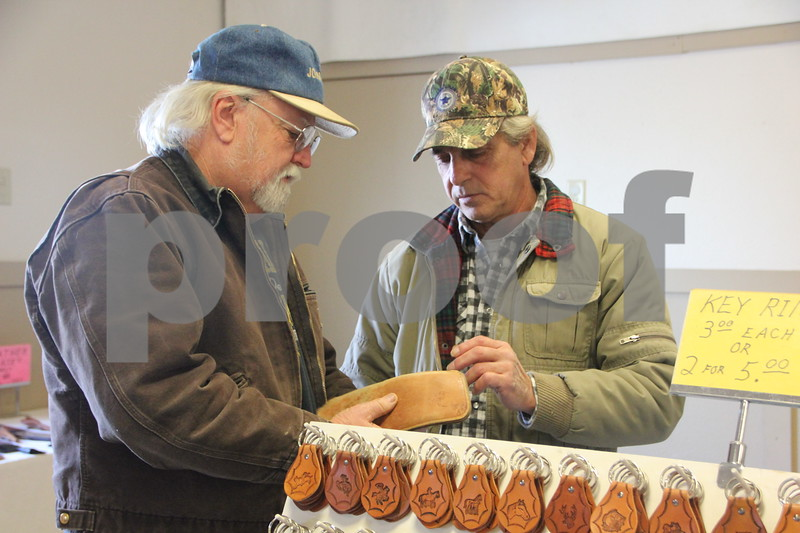 January, 14, 2017 the Fort Dodge Webster County Fairgrounds was the sight of the Winter Flea Market. Seen here is: Doug Linn (left) checking out the leather items made by Steve Boswell (right). Steve Boswell was one of several vendors at the event.
