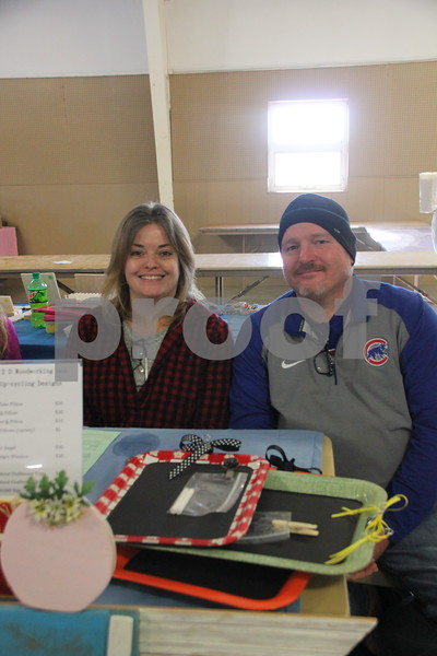 Shown here (left to right) is: Stephanie and Scott Day, another of the many vendors at the recent Flea Market. On January, 14, 2017 the Fort Dodge Webster County Fairgrounds was the sight of the Winter Flea Market.