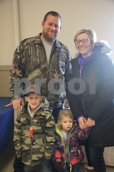 Shown here is: Back row (left to right) is: Simon and  Mallory Lindner and Front row (left to right) is: Cael and Ruby Lindner. They stopped by to check out the Winter Flea Market. On January, 14, 2017 the Fort Dodge Webster County Fairgrounds was the sight of the Winter Flea Market.