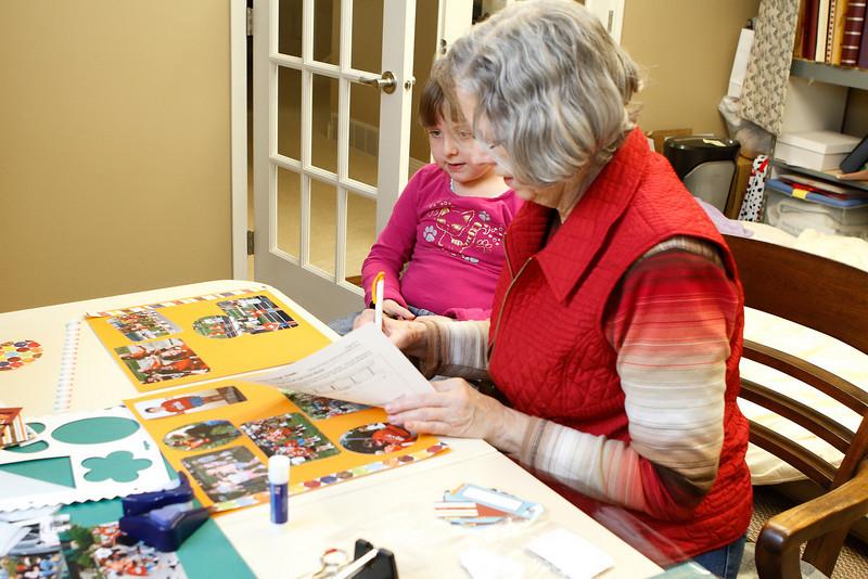 Elizabeth & mom working on Elizabeth's first scrapbook.