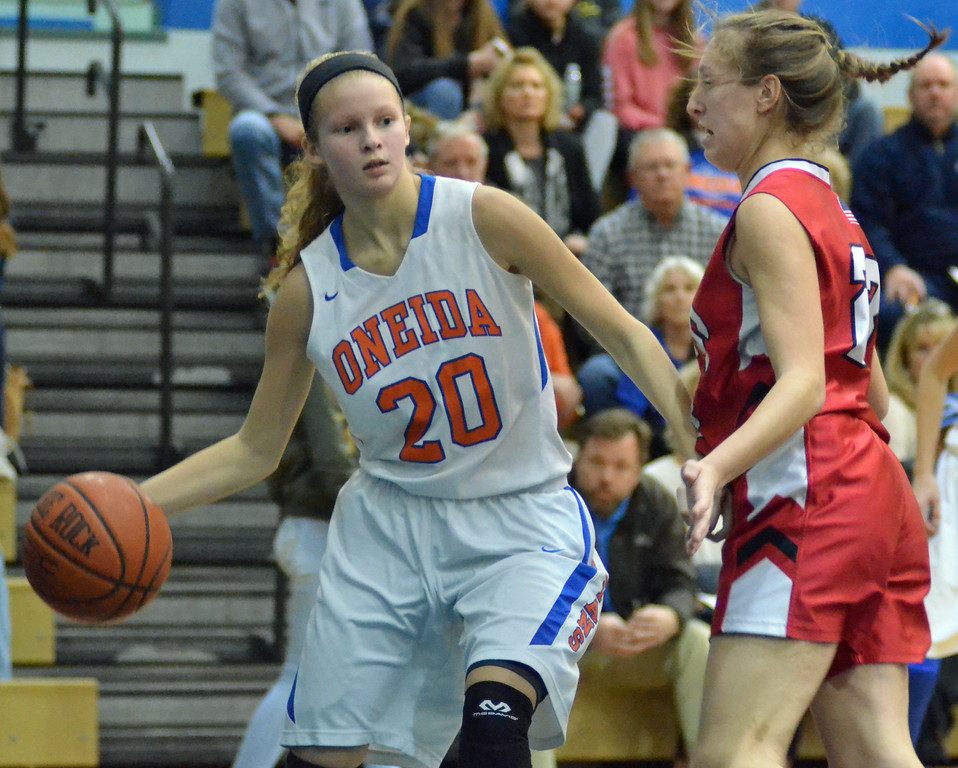 . KYLE MENNIG - ONEIDA DAILY DISPATCH Oneida\'s Lauren Skibitski (20) looks to pass while driving baseline as Vernon-Verona-Sherrill\'s McKenna Berry (23) defends during their game in Oneida on Friday, Jan. 27, 2017.