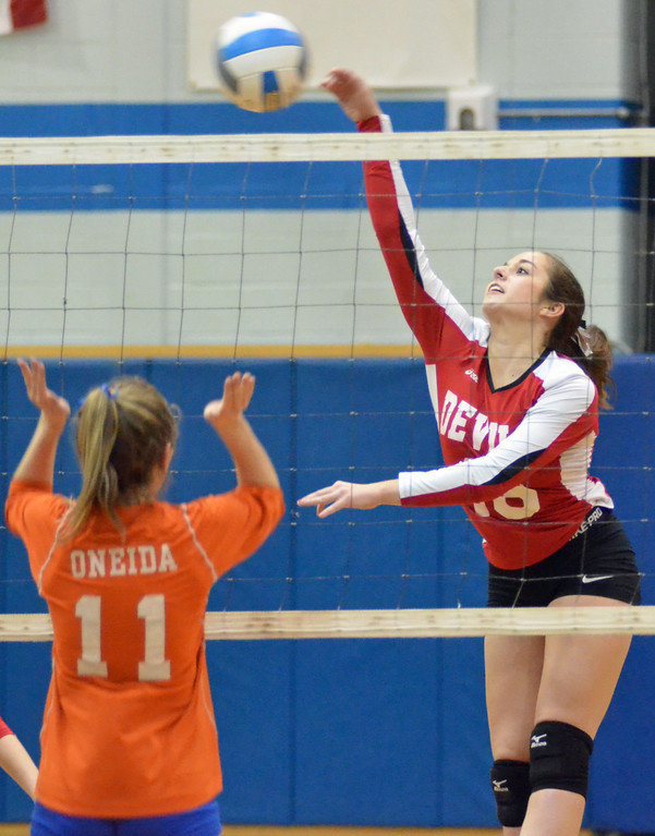 . KYLE MENNIG - ONEIDA DAILY DISPATCH Vernon-Verona-Sherrill\'s Kailey Roberts (16) hits the ball as Oneida\'s Schuyler Vecchiano (11) looks on during their match in Oneida on Monday, Jan. 23, 2016.