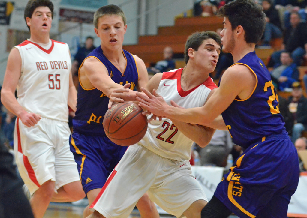 . KYLE MENNIG - ONEIDA DAILY DISPATCH Vernon-Verona-Sherrill\'s Nathan Palmer (22) is stripped of the ball by Holland Patent\'s DJ Harter (2) and Hunter Raehm (24) during their game in the Mohawk Valley Basketball Classic at Utica College on Saturday, Jan. 7, 2017.