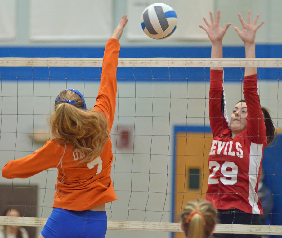 . KYLE MENNIG - ONEIDA DAILY DISPATCH Oneida\'s Julia Pickard (7) hits the ball at the net as Vernon-Verona-Sherrill\'s Kaitlyn Burback (29) defends during their match in Oneida on Monday, Jan. 23, 2016.