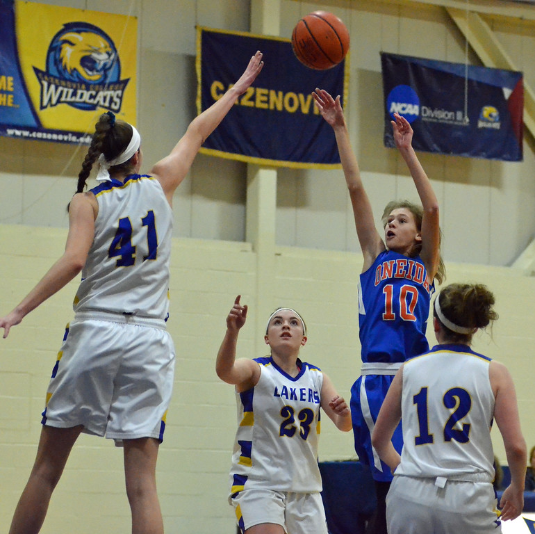 . KYLE MENNIG - ONEIDA DAILY DISPATCH Oneida\'s Sydney Lusher (10) puts up a shot over Cazenovia\'s Danielle Tedesco (41) during their game in Cazenovia, N.Y., on Saturday, Jan. 14, 2017.