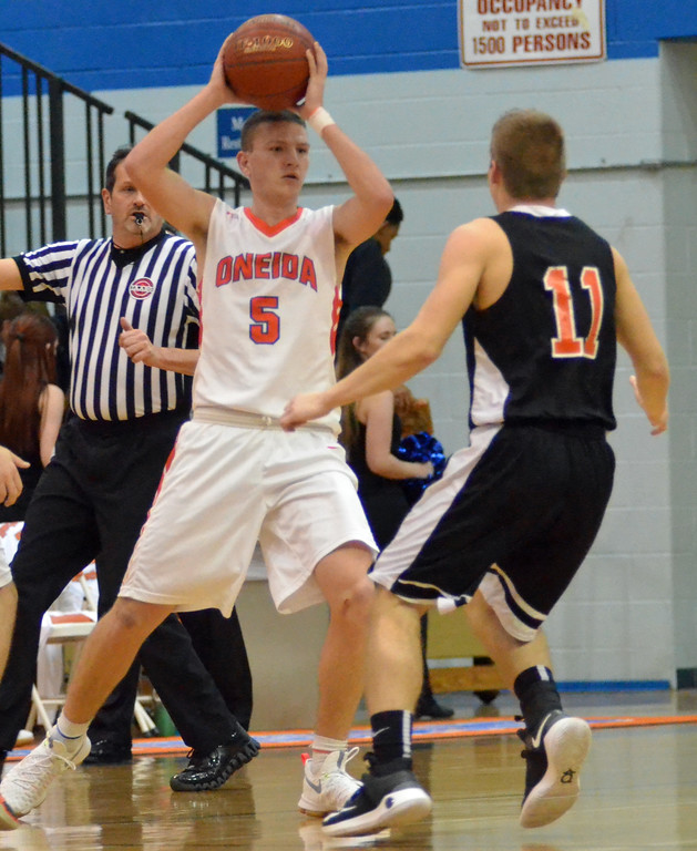 . KYLE MENNIG - ONEIDA DAILY DISPATCH Oneida\'s Jeffrey Coulter (5) looks to pass as Rome Free Academy\'s Tristan Hunzinger (11) defends during their game in Oneida, N.Y. on Tuesday, Jan. 17, 2017. Coulter scored his 1,000th career point in the loss.