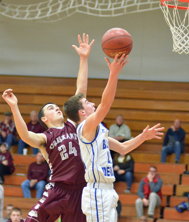 . KYLE MENNIG - ONEIDA DAILY DISPATCH Madison\'s Tyler Hummer (11) goes up for a layup in front of Oriskany\'s Richard Phelps (24) during their game in the Mohawk Valley Basketball Classic at Utica College on Saturday, Jan. 7, 2017.