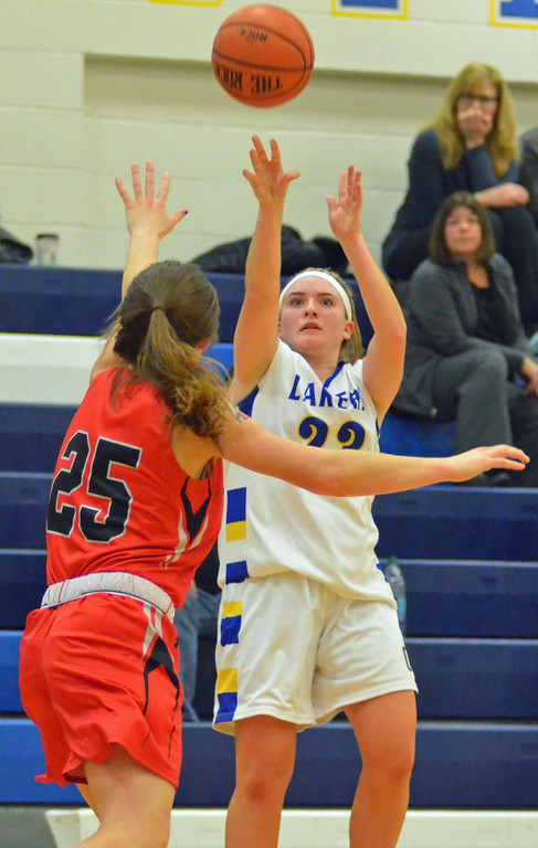 . KYLE MENNIG - ONEIDA DAILY DISPATCH Cazenovia\'s Saige Ackermann (23) puts up a shot over Chittenango\'s Sydney Bennett (25) during their game in Cazenovia on Tuesday, Jan. 31, 2017.