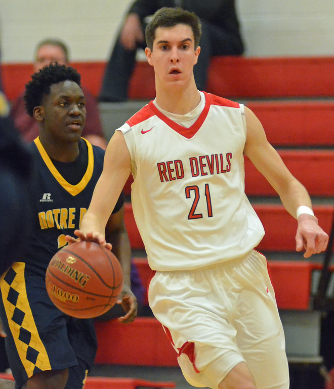 . KYLE MENNIG - ONEIDA DAILY DISPATCH Vernon-Verona-Sherrill\'s Jake Engler (21) brings the ball up the court in front of Utica Notre Dame\'s Douglas Smallwood (30) during their game in Verona, N.Y. on Friday, Jan. 20, 2017.