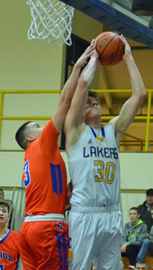 KYLE MENNIG - ONEIDA DAILY DISPATCH Cazenovia's Hunter Kowaleski (30) is fouled by Oneida's Alex Hawthorne (3) during their game in Cazenovia, N.Y., on Saturday, Jan. 14, 2017.