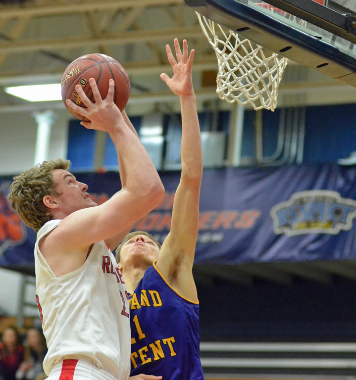 . KYLE MENNIG - ONEIDA DAILY DISPATCH Vernon-Verona-Sherrill\'s Davey Moffett (23) puts up a shot inside as Holland Patent\'s Collin Corrigan (21) defends during their game in the Mohawk Valley Basketball Classic at Utica College on Saturday, Jan. 7, 2017.