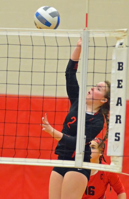 . KYLE MENNIG - ONEIDA DAILY DISPATCH Chittenango\'s Alyssa Bates (2) hits the ball at the net during a match against Fabius-Pompey in Chittenango on Wednesday, Jan. 18, 2017.
