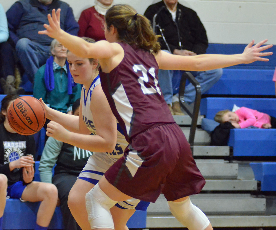 . KYLE MENNIG - ONEIDA DAILY DISPATCH Madison\'s Ashley Mayne (11) puts down a dribble as Stockbridge Valley\'s Olivia Marshall (21) defends during their game in Madison on Monday, Jan. 30, 2017.