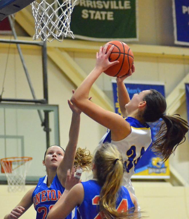 . KYLE MENNIG - ONEIDA DAILY DISPATCH Cazenovia\'s Lindsey Lawson (34) takes a shot between Oneida\'s Lauren Skibitski (20) and Julianna Cavanagh (24) during their game in Cazenovia, N.Y., on Saturday, Jan. 14, 2017.