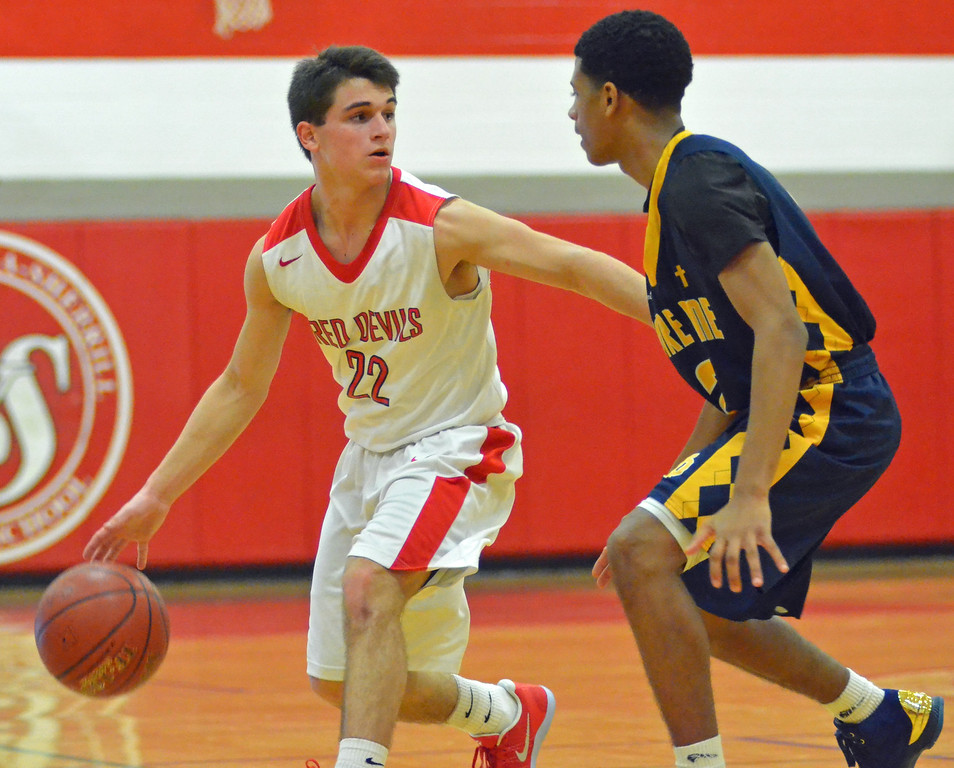 . KYLE MENNIG - ONEIDA DAILY DISPATCH Vernon-Verona-Sherrill\'s Nathan Palmer (22) dribbles as Utica Notre Dame\'s Jaylen Warmack (2) defends during their game in Verona, N.Y. on Friday, Jan. 20, 2017.