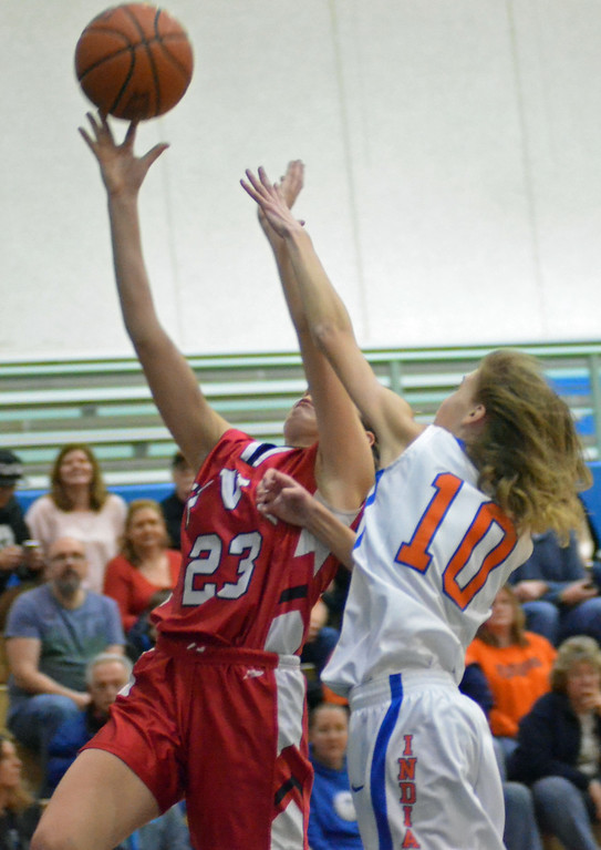 . KYLE MENNIG - ONEIDA DAILY DISPATCH Vernon-Verona-Sherrill\'s McKenna Berry (23) goes up for a layup as Oneida\'s Sydney Lusher (10) defends during their game in Oneida on Friday, Jan. 27, 2017.