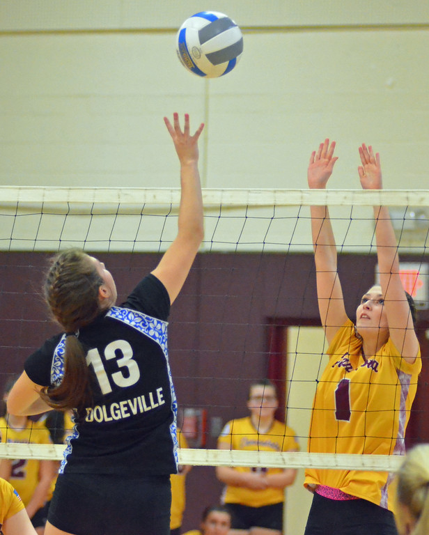 . KYLE MENNIG - ONEIDA DAILY DISPATCH Dolgeville\'s Raquel Borst (13) hits the ball at the net as Canastota\'s Haley Morris (1) goes up to defend during their match in Canastota, N.Y., on Wednesday, Jan. 11, 2017.