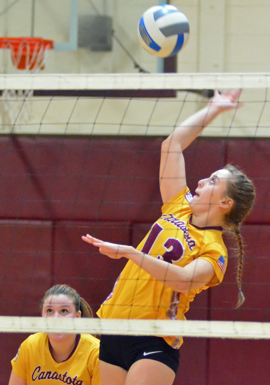. KYLE MENNIG - ONEIDA DAILY DISPATCH Canastota\'s Kara Niles (13) hits the ball at the net against Dolgeville during their match in Canastota, N.Y., on Wednesday, Jan. 11, 2017.